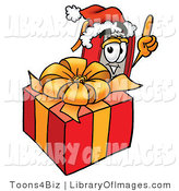 Clip Art of a Christmassy Red Book Mascot Cartoon Character Standing by a Christmas Present by Toons4Biz