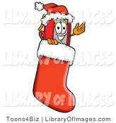 Clip Art of a Festive Red Book Mascot Cartoon Character Wearing a Santa Hat Inside a Red Christmas Stocking by Toons4Biz