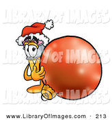 Clip Art of a Festive Yellow Pencil Mascot Cartoon Character Wearing a Santa Hat, Standing with a Christmas Bauble by Toons4Biz